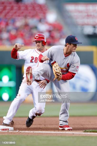 David Freese of the St Louis Cardinals gets a force out at third base on Chris Heisey of the Cincinnati Reds at Great American Ball Park on April 9...