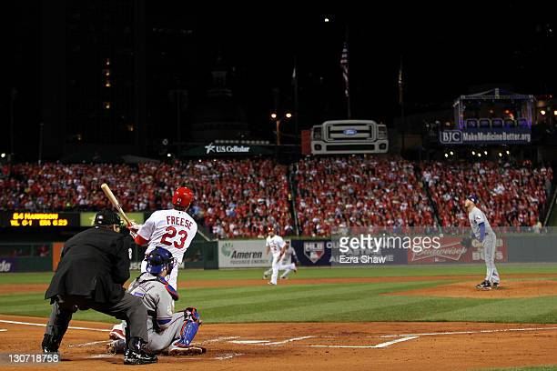 David Freese of the St. Louis Cardinals hits a two-run double in the first inning off of Matt Harrison of the Texas Rangers during Game Seven of the...