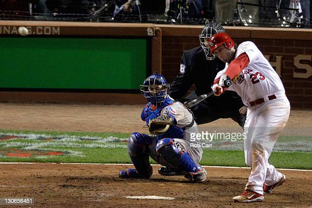 David Freese of the St Louis Cardinals hits a tworun RBI triple to tie the game in the bottom of the ninth during Game Six of the MLB World Series...