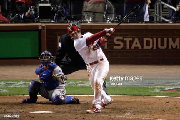 David Freese of the St Louis Cardinals hits a walk off solo home run in the 11th inning to win Game Six of the MLB World Series against the Texas...