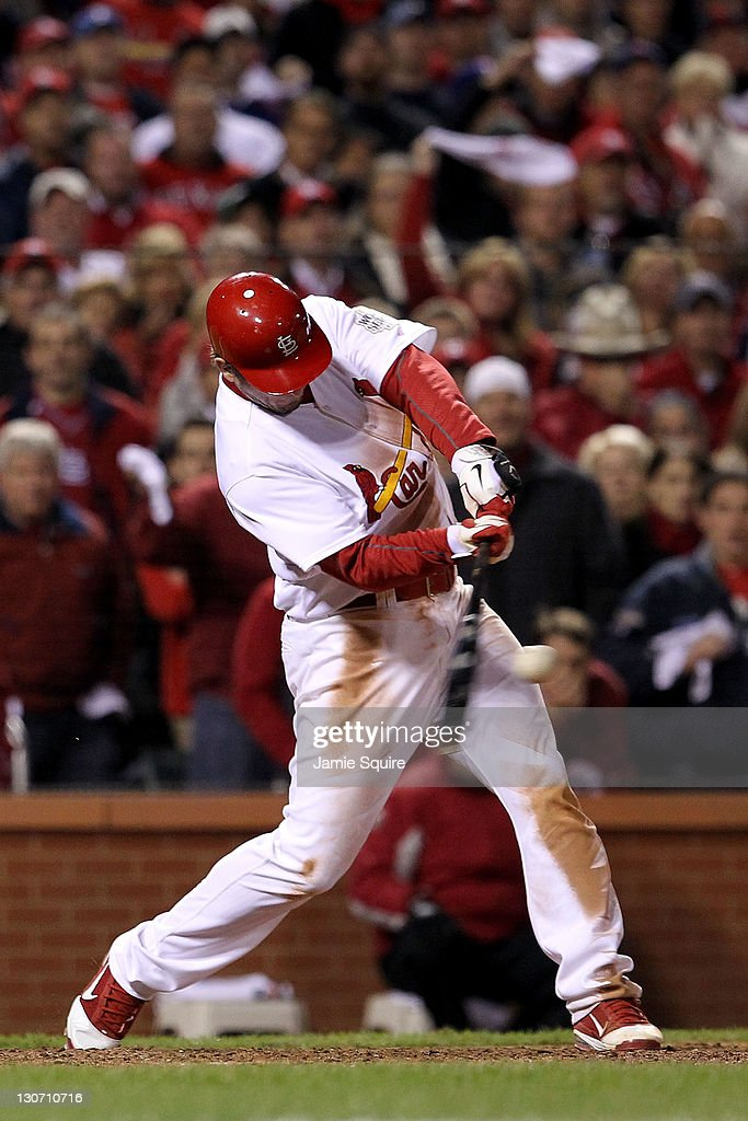 David Freese #23 of the St. Louis Cardinals hits a walk off solo home run in the 11th inning to win Game Six of the MLB World Series against the Texas Rangers at Busch Stadium on October 27, 2011 in St Louis, Missouri. The Cardinals won 10-9.