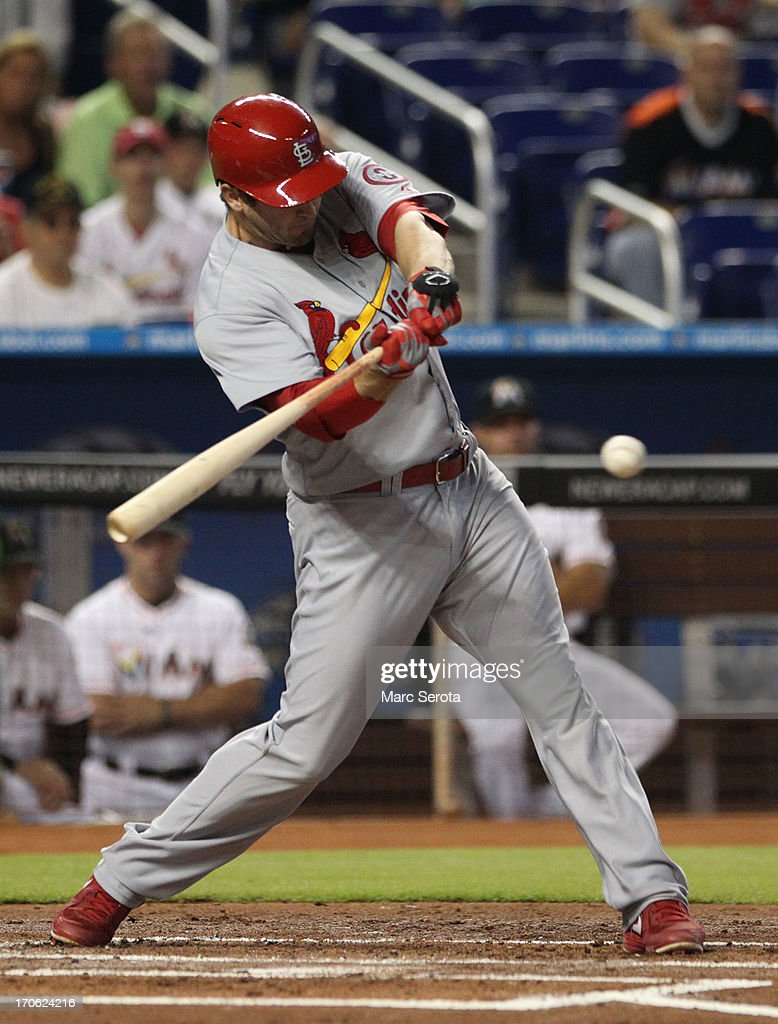 David Freese #23 of the St. Louis Cardinals hits an RBI single against the Miami Marlins during the first inning at Marlins Park on June 15, 2013 in Miami, Florida.
