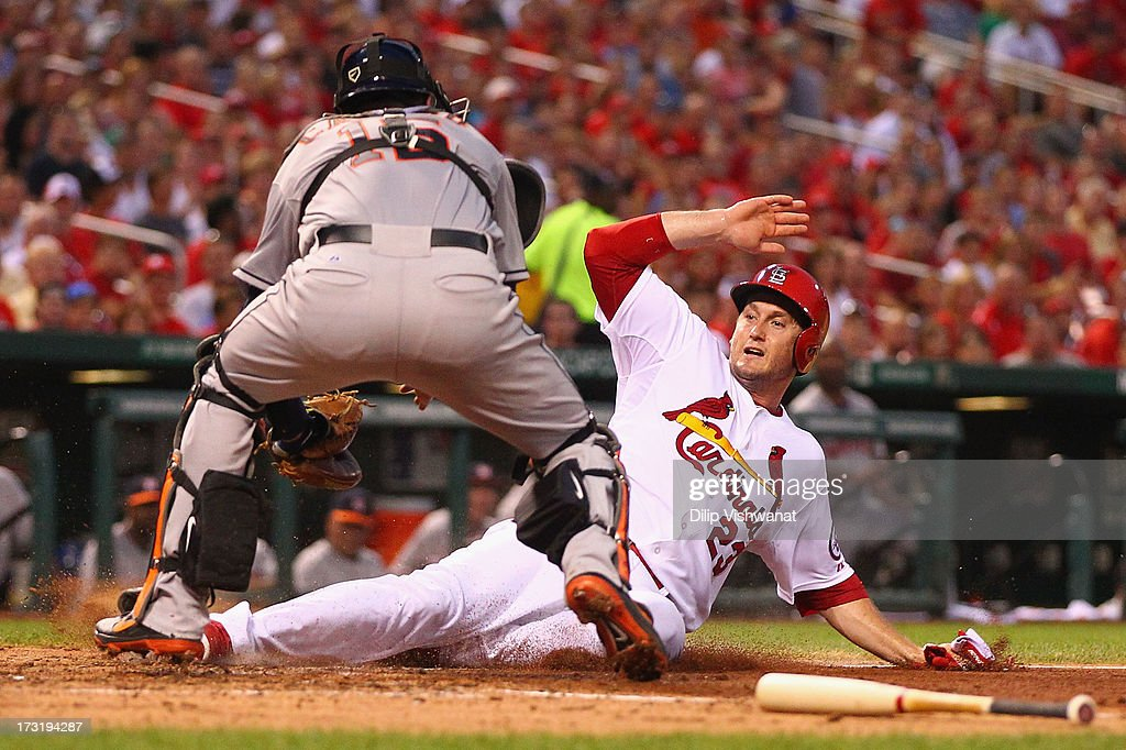 David Freese #23 of the St. Louis Cardinals is tagged out at home by Jason Castro #15 of the Houston Astros in the fourth inning at Busch Stadium on July 9, 2013 in St. Louis, Missouri.