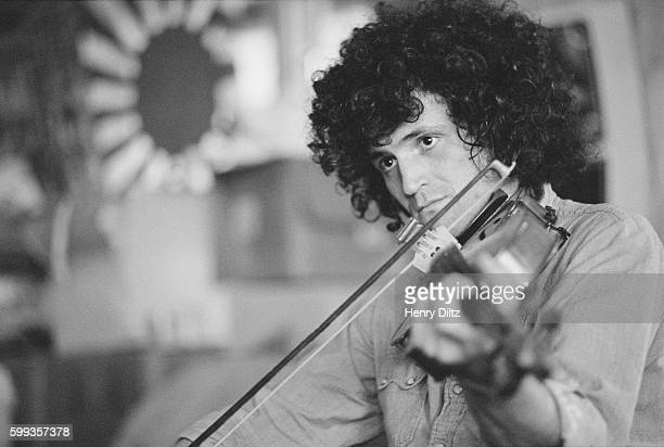 David Freiberg of the San Francisco psychedelic band Quicksilver Messenger Service plays a violin during a rehearsal jam session at the home of Grace...