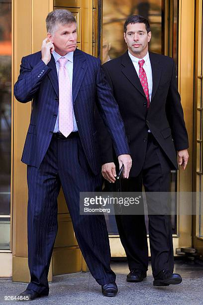 David Friehling the accountant for con artist Bernard Bernie Madoff right leaves federal court after entering a guilty plea in New York US on Tuesday...