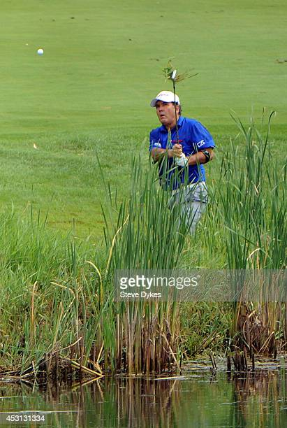 David Frost hits his ball out of the rough on the sixth hole during the final round of the 3M Championship at TPC Twin Cities on August 3 2014 in...