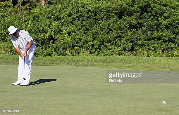 David Frost of South Africa holes his eagle putt on the 18th green during the final round of the Mauritius Commercial Bank Open played at Constance...