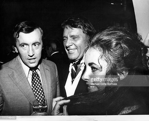David Frost, Richard Burton and Elizabeth Taylor at the British Consul bash, 1972.
