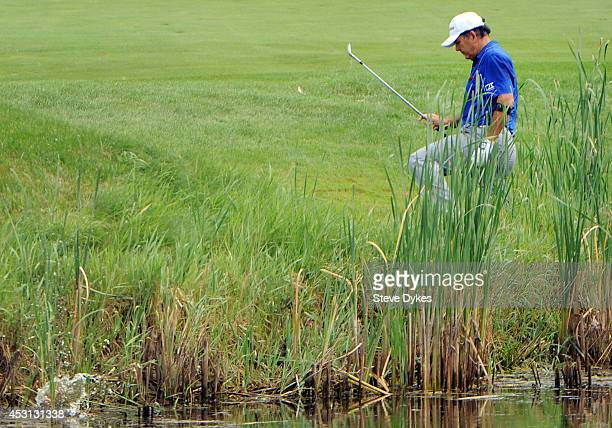 David Frost's ball lands in the water as he walks out of the rough on the sixth hole during the final round of the 3M Championship at TPC Twin Cities...