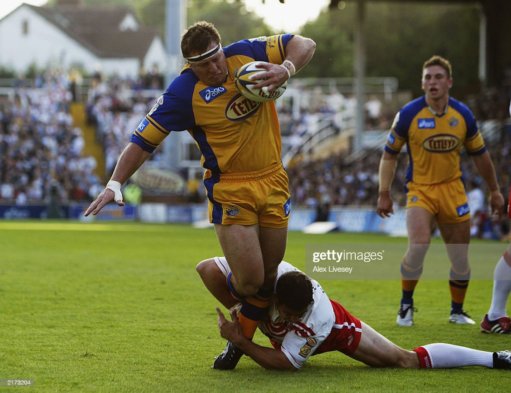 David Furner of Leeds Rhinos is brought down by Mike Bennett of St Helens during the Tetley's Super League match between Leeds Rhinos and St Helens held on June 13, 2003 at the Headingley Stadium in Leeds, England. Leeds Rhinos won the match 20-14.