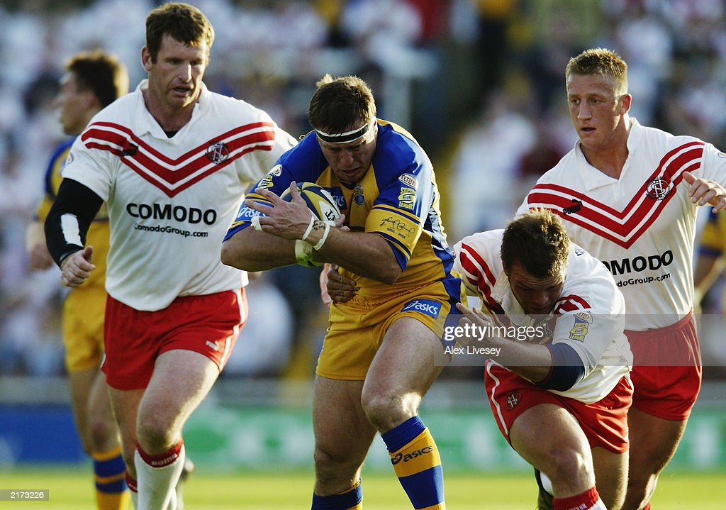 David Furner of Leeds Rhinos is tackled by Keiron Cunningham of St Helens during the Tetley's Super League match between Leeds Rhinos and St Helens held on June 13, 2003 at the Headingley Stadium in Leeds, England. Leeds Rhinos won the match 20-14.