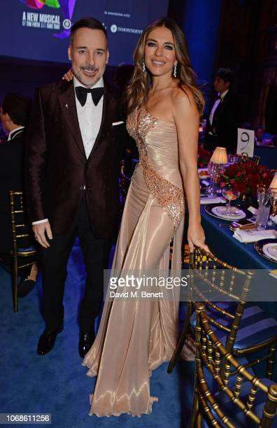 "David Furnish and Elizabeth Hurley attend the Opening Night Gala of ""The Band"" to benefit the Elton John AIDS Foundation supported by The Evening..."