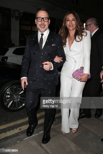 David Furnish and Elizabeth Hurley seen attending Rocketman UK film afterparty at Quaglino's on May 20 2019 in London England