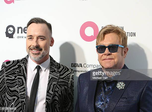 David Furnish and Elton John arrive at the 24th Annual Elton John AIDS Foundation's Oscar viewing party held at West Hollywood Park on February 28...