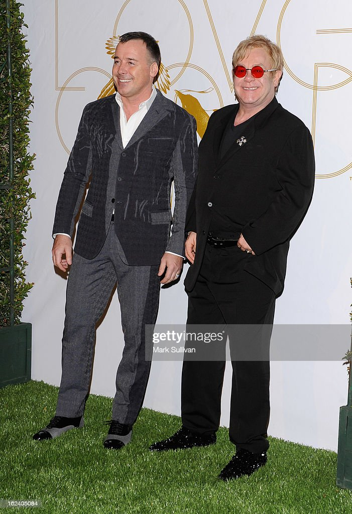 David Furnish (L) and Elton John arrive at the LOVEGOLD cocktail party to celebrate 'How To Survive A Plague' at Chateau Marmont on February 22, 2013 in Los Angeles, California.