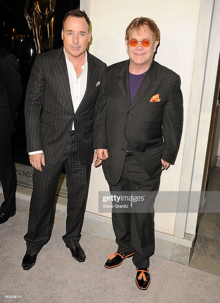 David Furnish and Elton John arrives at the Tom Ford Cocktails In Support Of Project Angel Food at TOM FORD on February 21, 2013 in Beverly Hills, California.