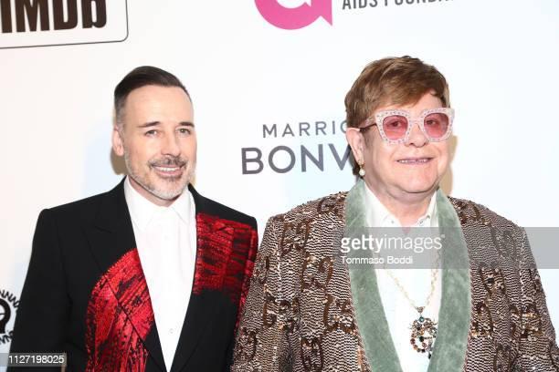 David Furnish and Elton John attend IMDb LIVE At The Elton John AIDS Foundation Academy Awards® Viewing Party on February 24, 2019 in Los Angeles,...