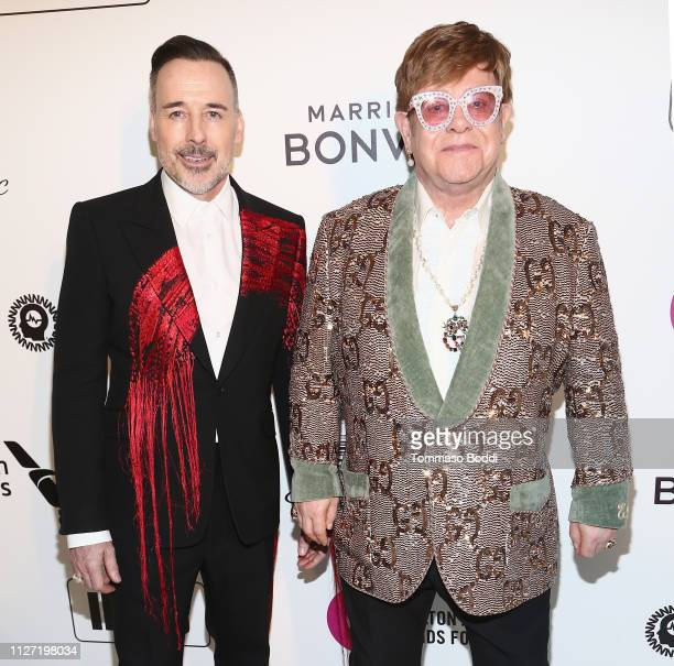 David Furnish and Elton John attend IMDb LIVE At The Elton John AIDS Foundation Academy Awards® Viewing Party on February 24 2019 in Los Angeles...