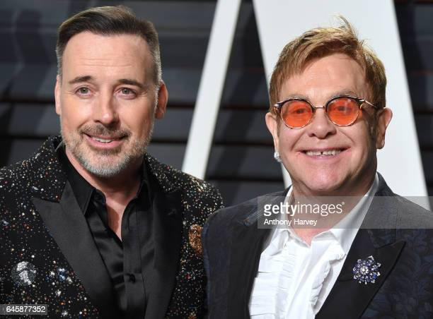 David Furnish and Elton John attend the 2017 Vanity Fair Oscar Party hosted by Graydon Carter at Wallis Annenberg Center for the Performing Arts on...
