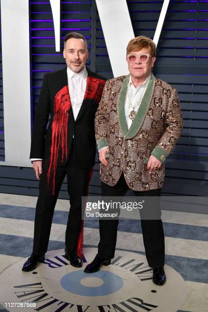 David Furnish and Elton John attend the 2019 Vanity Fair Oscar Party hosted by Radhika Jones at Wallis Annenberg Center for the Performing Arts on...