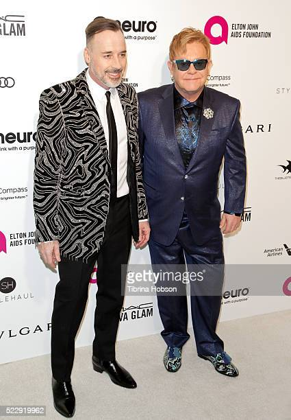 David Furnish and Elton John attend the 24th annual Elton John AIDS Foundation's Oscar Party on February 28, 2016 in West Hollywood, California.