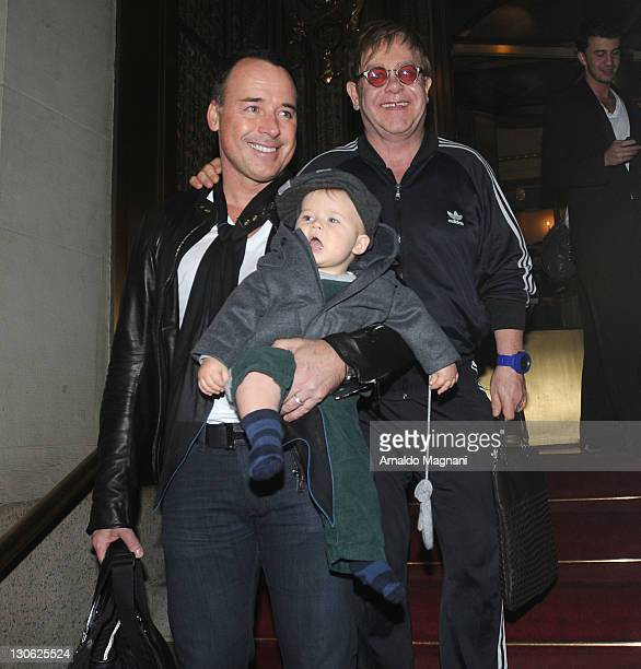 David Furnish and Elton John with their son Zachary leaving their hotel on October 27, 2011 in New York City.