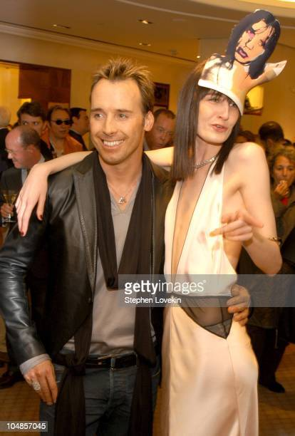 David Furnish and Erin O'Connor during Philip Treacy Shows His Spring 2003 Hat Collection at Bergdorf's at Bergdorf Goodman in New York City, NY,...