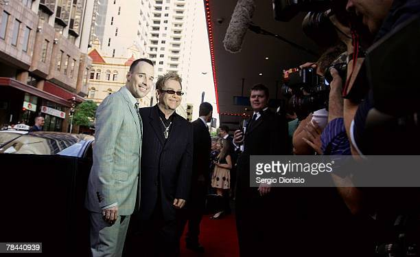 David Furnish and his partner Sir Elton John attends the Sydney premiere of Billy Elliot The Musical at the Capitol Theatre on December 13 2007 in...