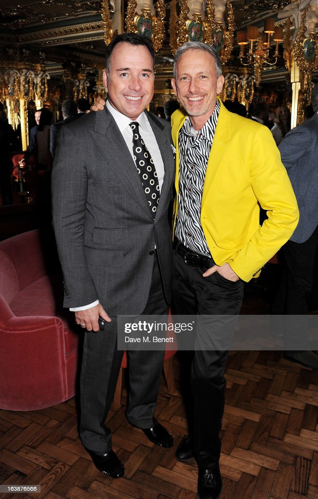 David Furnish (L) and Patrick Cox attend a drinks reception celebrating Patrick Cox's 50th Birthday party at Cafe Royal on March 15, 2013 in London, England.