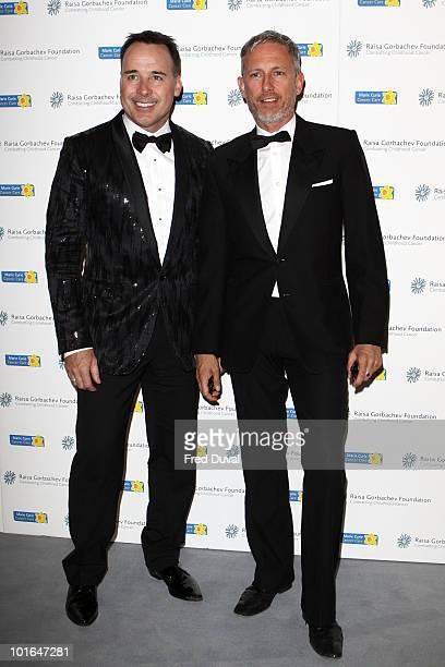 David Furnish and Patrick Cox attend the annual Raisa Gorbachev Foundation Party at Stud House Hampton Court on June 5 2010 in London England