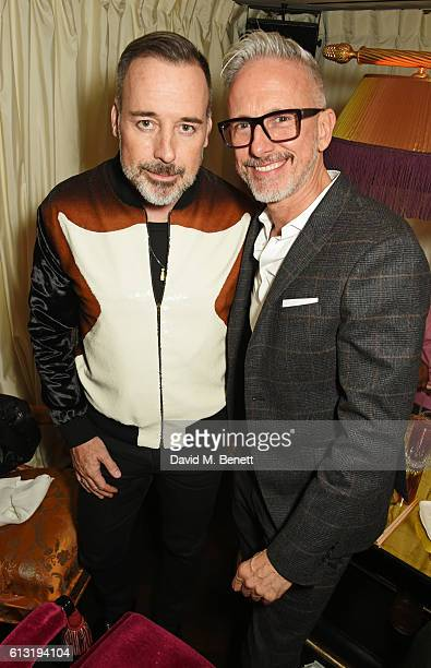David Furnish and Patrick Cox attend the Moncler 'Freeze For Frieze' Dinner Party at the Moncler Bond Street Boutique on October 7 2016 in London...
