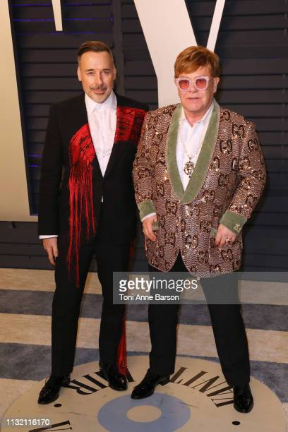 David Furnish and Sir Elton John attend the 2019 Vanity Fair Oscar Party hosted by Radhika Jones at Wallis Annenberg Center for the Performing Arts...