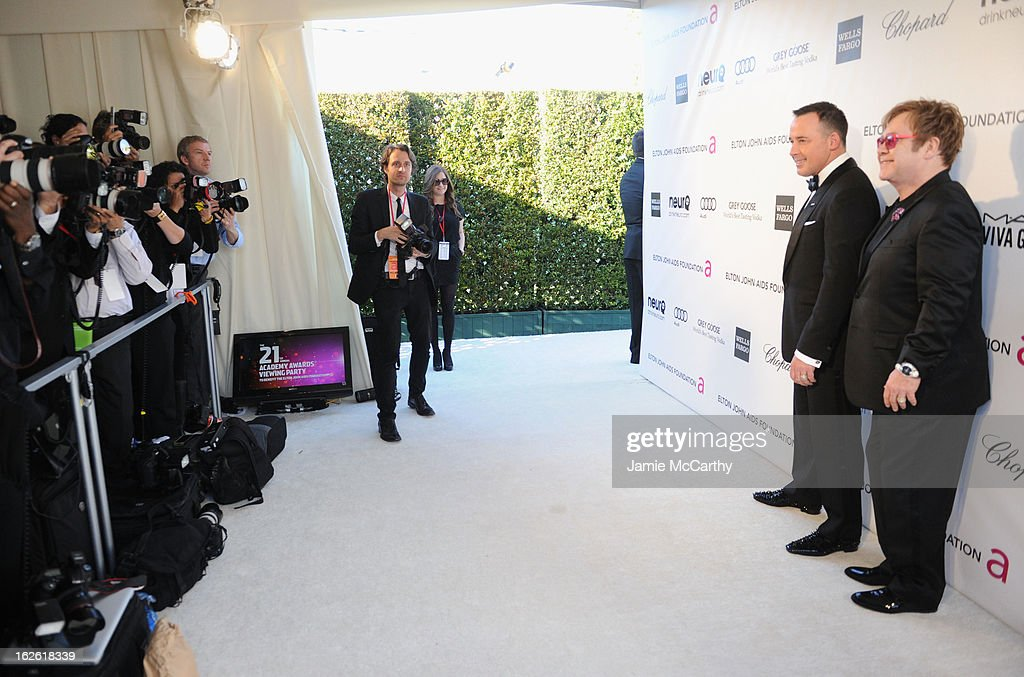 David Furnish and Sir Elton John attend the 21st Annual Elton John AIDS Foundation Academy Awards Viewing Party at West Hollywood Park on February 24, 2013 in West Hollywood, California.