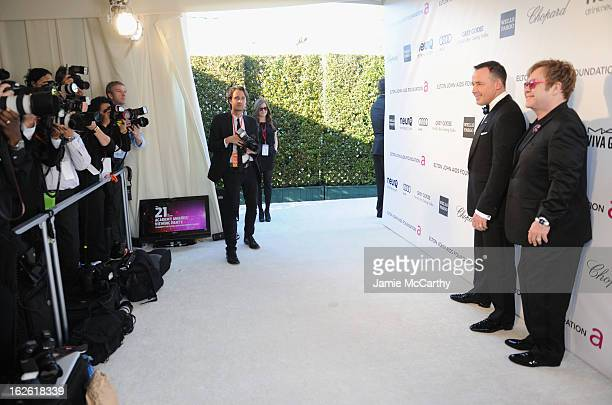 David Furnish and Sir Elton John attend the 21st Annual Elton John AIDS Foundation Academy Awards Viewing Party at West Hollywood Park on February 24...