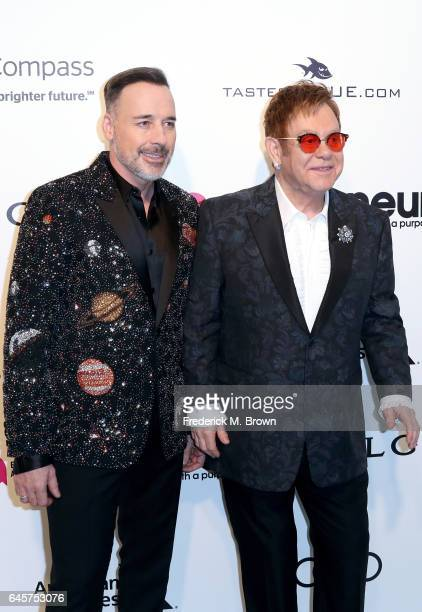 David Furnish and Sir Elton John attend the 25th Annual Elton John AIDS Foundation's Academy Awards Viewing Party at The City of West Hollywood Park...