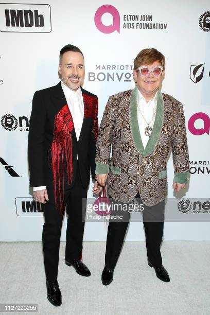 David Furnish and Sir Elton John attend the 27th Annual Elton John AIDS Foundation Academy Awards Viewing Party Celebrating EJAF and The 91st Academy...