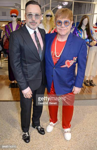 David Furnish and Sir Elton John attend the Gucci Elton John Capsule launch hosted by Dover Street Market Gucci at Dover Street Market on April 17...