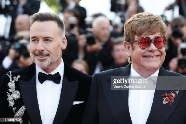 David Furnish and Sir Elton John attend the screening of Rocketman during the 72nd annual Cannes Film Festival on May 16 2019 in Cannes France