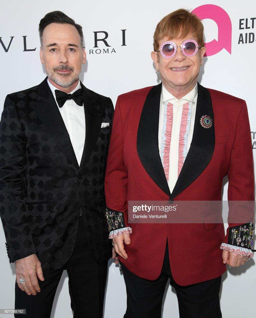 David Furnish (L) and Sir Elton John attends Elton John AIDS Foundation 26th Annual Academy Awards Viewing Party at The City of West Hollywood Park on March 4, 2018 in Los Angeles, California.