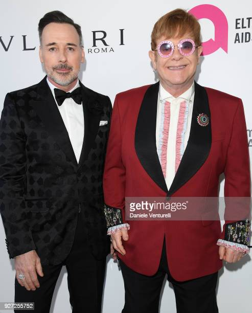 David Furnish and Sir Elton John attends Elton John AIDS Foundation 26th Annual Academy Awards Viewing Party at The City of West Hollywood Park on...