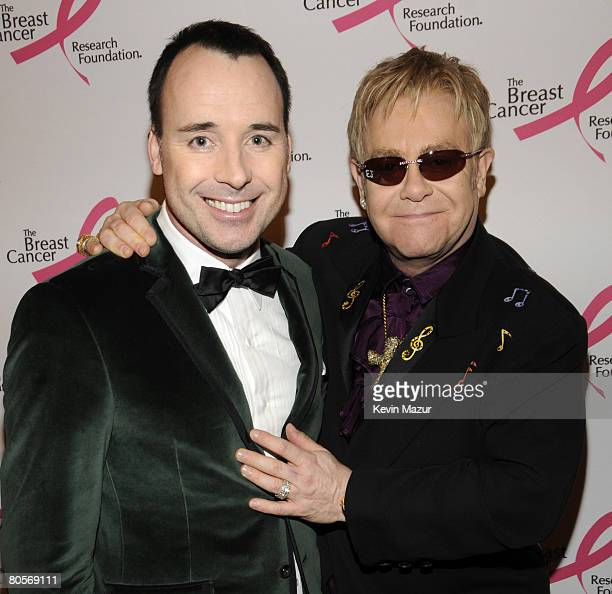 NEW YORK APRIL 08 David Furnish and Sir Elton John in the green room at the Waldorf Astoria during The Breast Cancer Research Foundation's Hottest...