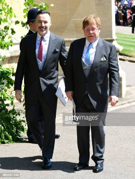 David Furnish and Sir Elton John leave St George's Chapel at Windsor Castle after the wedding of Meghan Markle and Prince Harry on May 19 2018 in...
