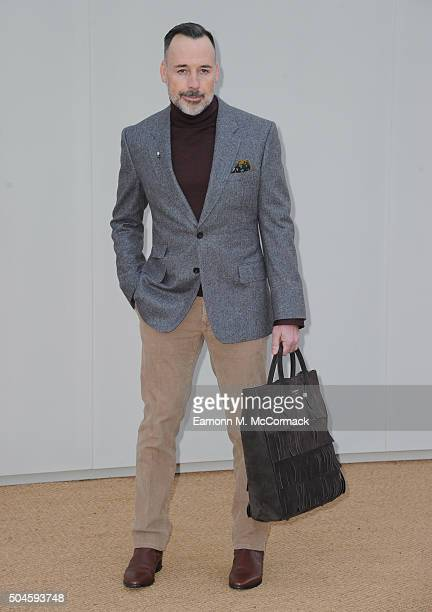 David Furnish attends the Burberry show during The London Collections Men AW16 at Kensington Gardens on January 11 2016 in London England