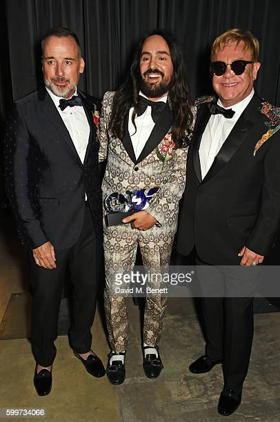 David Furnish Designer of the Year Alessandro Michele and Sir Elton John attend the GQ Men Of The Year Awards 2016 at the Tate Modern on September 6...