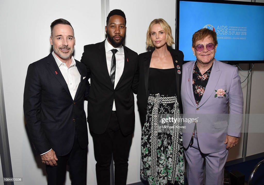 David Furnish, EJAF Chairman, Ndaba Mandela, actress Charlize Theron, and Sir Elton John attend the Launch of the Menstar Coalition To Promote HIV Testing & Treatment of Men on July 24, 2018 in Amsterdam, Netherlands.