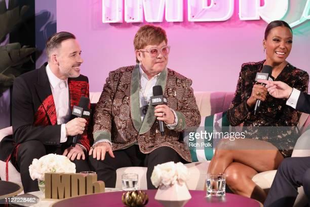 David Furnish, Elton John and host Aisha Tyler attend IMDb LIVE At The Elton John AIDS Foundation Academy Awards® Viewing Party on February 24, 2019...