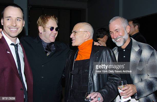 David Furnish Elton John Larry Kramer and his partner at the amFAR and ACRIA Benefit Honoring Herb Ritts held at Sotheby's