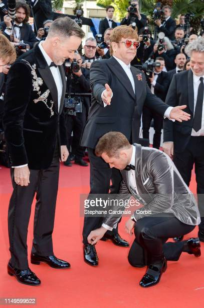 David Furnish Elton John Taron Egerton and Dexter Fletcher attends the screening of Rocketman during the 72nd annual Cannes Film Festival on May 16...