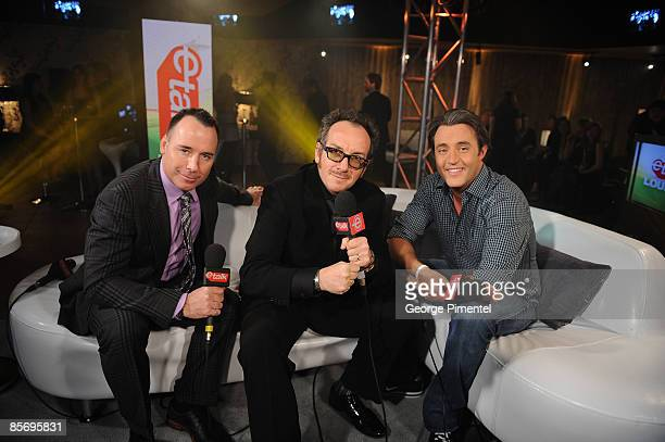 David Furnish Elvis Costello and Ben Mulroney backstage in the E Talk Lounge at the 2009 Juno Awards at General Motors Place on March 29 2009 in...