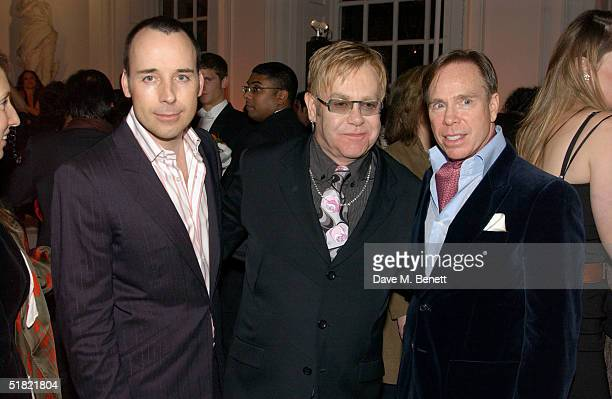 "David Furnish, singer Elton John and fashion designer Tommy Hilfiger attend the ""Women To Women: Positively Speaking"" book launch gala at The..."